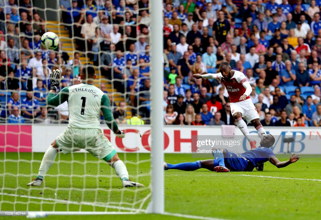 Alexandre Lacazette of Arsenal scores his team's third goal past Neil Etheridge of Cardiff City during the Premier League match between Cardiff City and Arsenal FC at Cardiff City Stadium on September 2, 2018 in Cardiff, United Kingdom.