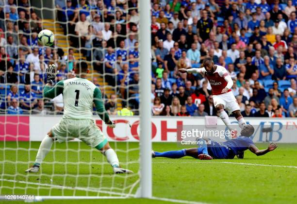 Alexandre Lacazette of Arsenal scores his team's third goal past Neil Etheridge of Cardiff City during the Premier League match between Cardiff City...