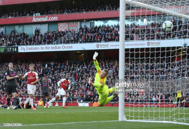 Alexandre Lacazette of Arsenal scores the first goal during the Premier League match between Arsenal FC and Everton FC at Emirates Stadium on...