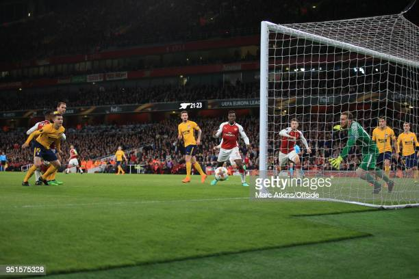 Alexandre Lacazette of Arsenal scores the opening goal during the UEFA Europa League Semi Final 1st Leg match between Arsenal FC and Atletico Madrid...