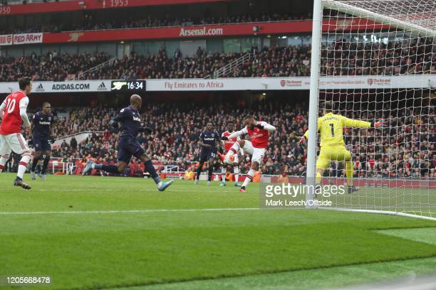 Alexandre Lacazette of Arsenal scores the winning goal during the Premier League match between Arsenal FC and West Ham United at Emirates Stadium on...