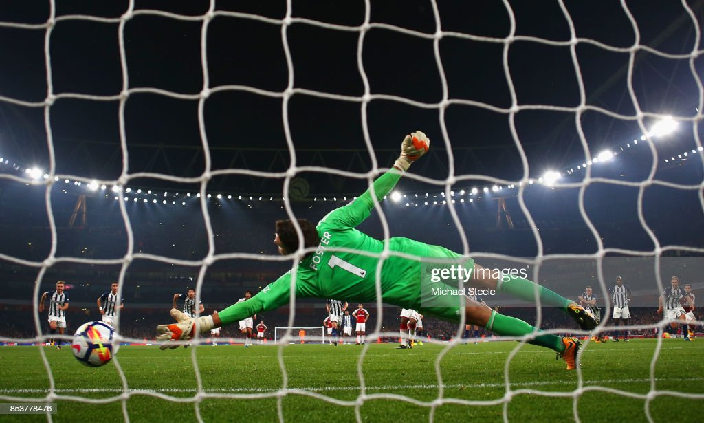 Alexandre Lacazette of Arsenal (obscured) scores their second goal from a penalty past Ben Foster of West Bromwich Albion during the Premier League match between Arsenal and West Bromwich Albion at Emirates Stadium on September 25, 2017 in London, England.
