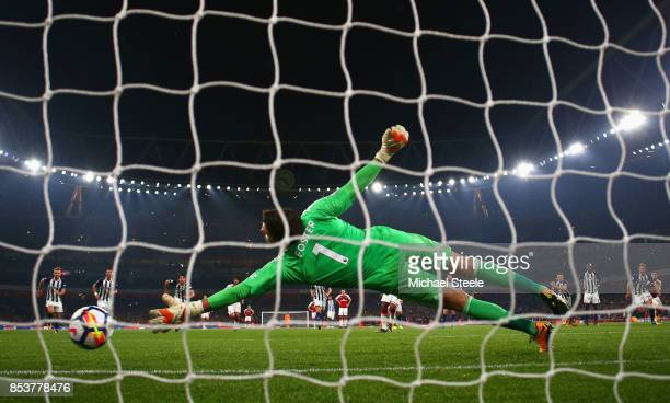 Alexandre Lacazette of Arsenal scores their second goal from a penalty past Ben Foster of West Bromwich Albion during the Premier League match...