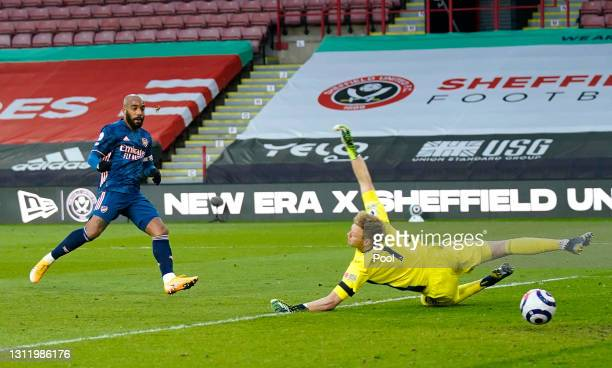 Alexandre Lacazette of Arsenal scores their side's first goal past Aaron Ramsdale of Sheffield United during the Premier League match between...