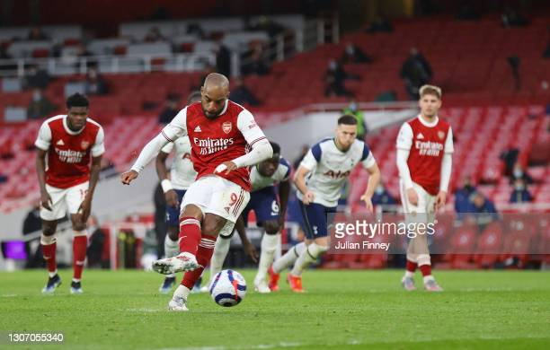 Alexandre Lacazette of Arsenal scores their side's second goal from the penalty spot during the Premier League match between Arsenal and Tottenham...