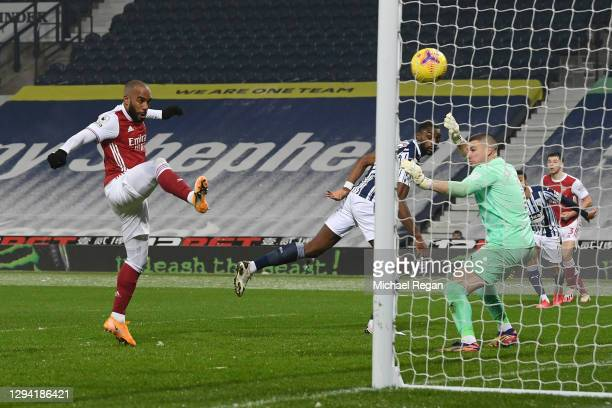 Alexandre Lacazette of Arsenal scores their team's fourth goal during the Premier League match between West Bromwich Albion and Arsenal at The...