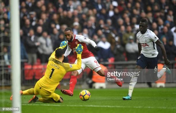 Alexandre Lacazette of Arsenal shoots under pressure from Hugo Lloris of Tottenham during the Premier League match between Tottenham Hotspur and...