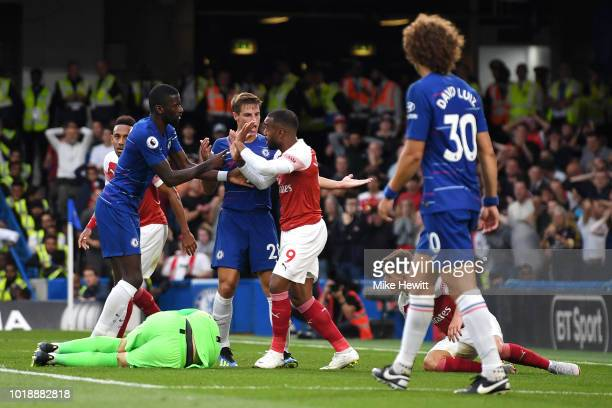 Alexandre Lacazette of Arsenal speaks with Antonio Rüdiger and Cesar Azpilicueta of Chelsea following a missed chance during the Premier League match...
