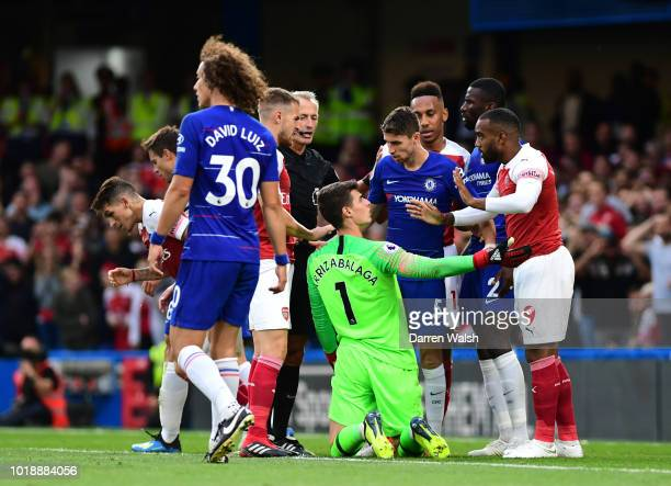 Alexandre Lacazette of Arsenal speaks with Kepa Arrizabalaga of Chelsea following a missed chance during the Premier League match between Chelsea FC...