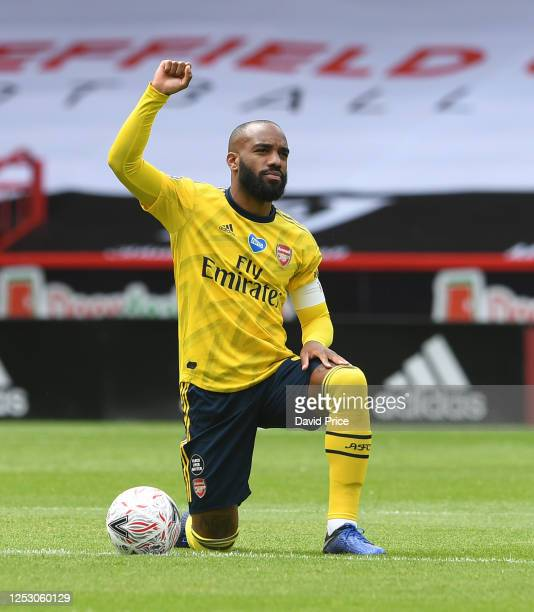 Alexandre Lacazette of Arsenal takes a knee before the FA Cup Fifth Quarter Final match between Sheffield United and Arsenal FC at Bramall Lane on...