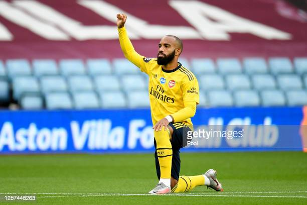 Alexandre Lacazette of Arsenal takes a knee in support of the Black Lives Matter movement prior to during the Premier League match between Aston...