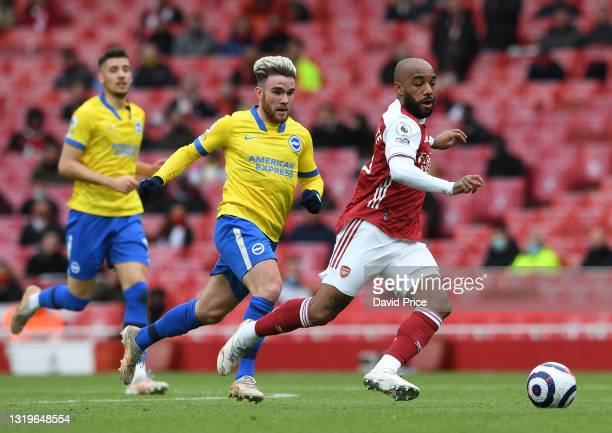 Alexandre Lacazette of Arsenal takes on Aaron Connolly of Brighton during the Premier League match between Arsenal and Brighton & Hove Albion at...