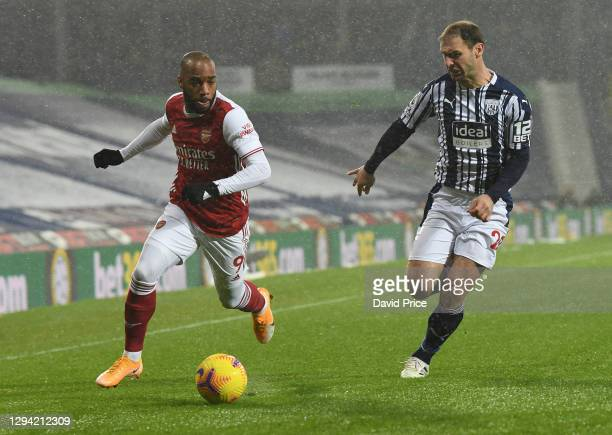 Alexandre Lacazette of Arsenal takes on Branislav Ivanovic of WBA during the Premier League match between West Bromwich Albion and Arsenal at The...