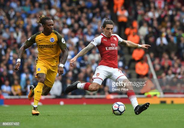 Alexandre Lacazette of Arsenal takes on Gaetan Bong of Brighton during the Premier League match between Arsenal and Brighton and Hove Albion at...