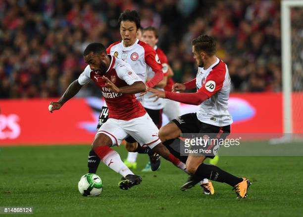 Alexandre Lacazette of Arsenal takes on Josh Risdon of Western Wanderers during the match between the Western Sydney Wanderers and Arsenal FC at ANZ...