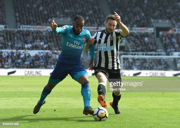 Alexandre Lacazette of Arsenal takes on Paul Dummett of Newcastle during the Premier League match between Newcastle United and Arsenal at St James...
