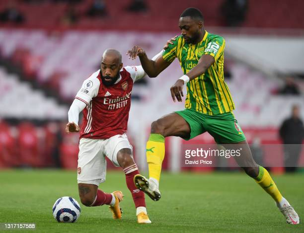 Alexandre Lacazette of Arsenal takes on Semi Ajayi of West Brom during the Premier League match between Arsenal and West Bromwich Albion at Emirates...