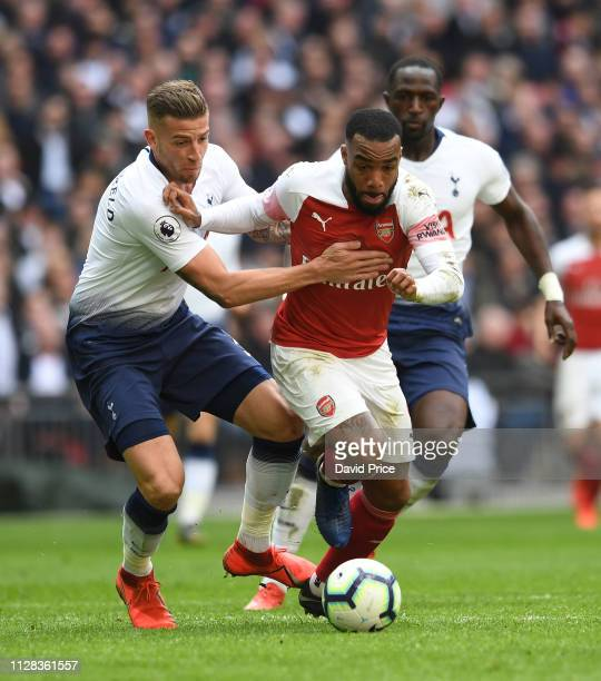 Alexandre Lacazette of Arsenal takes on Toby Alderweireld of Tottenham during the Premier League match between Tottenham Hotspur and Arsenal FC at...