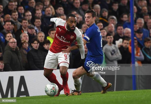 Alexandre Lacazette of Arsenal turns away from Cesar Azpilicueta of Chelsea during the Carabao Cup Semie Final 1st leg match between Chelsea and...