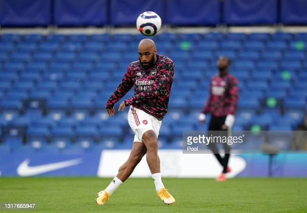Alexandre Lacazette of Arsenal warms up prior to the Premier League match between Chelsea and Arsenal at Stamford Bridge on May 12, 2021 in London,...