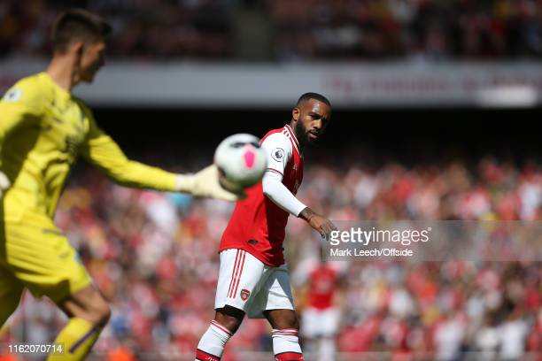 Alexandre Lacazette of Arsenal watches as the Burnley goalkeeper Nick Pope clears the ball during the Premier League match between Arsenal FC and...