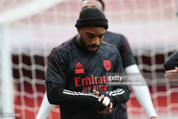Alexandre Lacazette of Arsenal with a bandaged finger ahead of the Premier League match between Arsenal and Tottenham Hotspur at Emirates Stadium on...