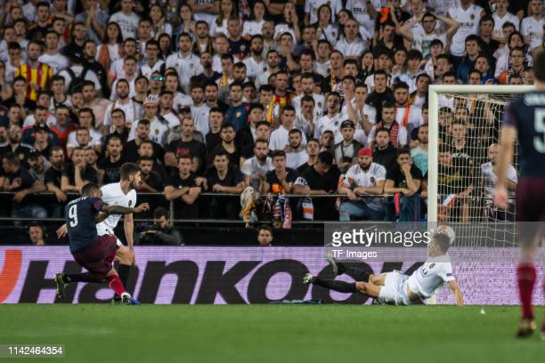 Alexandre Lacazette of FC Arsenal scores his teams second goal during the UEFA Europa League Semi Final Second Leg match between Valencia and Arsenal...