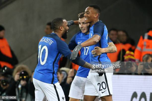 Alexandre Lacazette of France celebrates his goal with Lucas Digne and Anthony Martial during the international friendly match between Germany and...