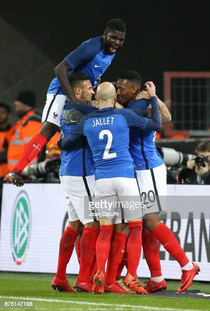 Alexandre Lacazette of France celebrates his goal with Samuel Umtiti Corentin Tolisso Christophe Jallet Anthony Martial during the international...