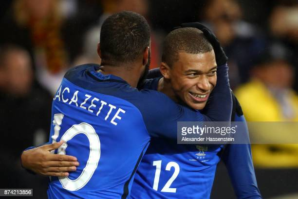 Alexandre Lacazette of France celebrates scoring his sides second goal with Kylian Mbappe of France during the international friendly match between...