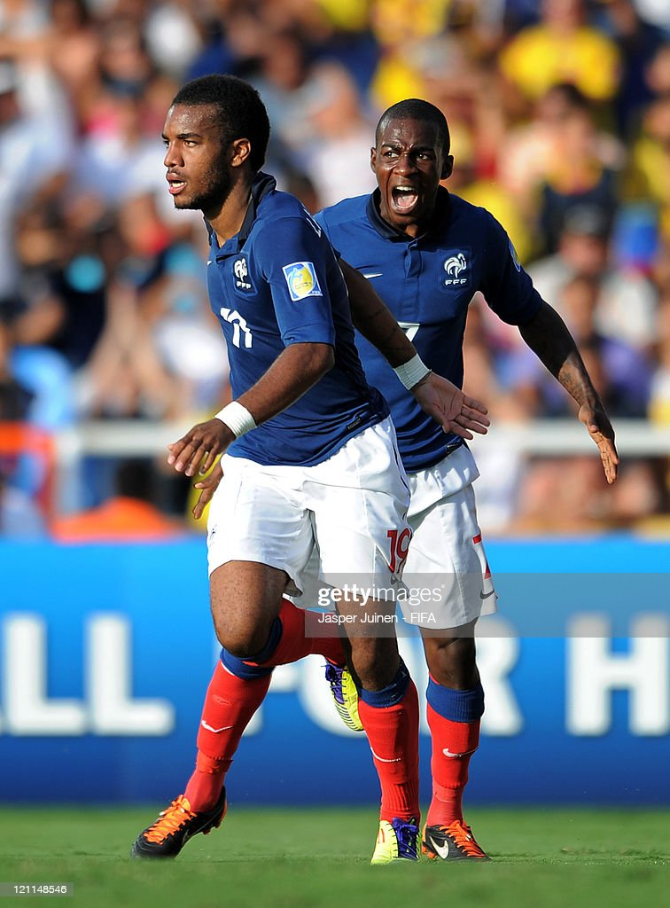 Alexandre Lacazette (L) of France celebrates scoring his sides third goal with his teammate Gael Kakuta during the FIFA U-20 World Cup Colombia 2011 quarter final match between France and Nigeria on August 14, 2011 in Cali, Colombia.