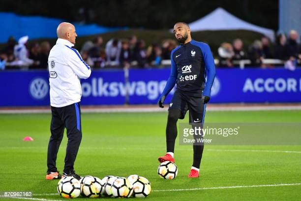 Alexandre Lacazette of France chats with France assistant coach Guy Stephan during the training session at the Centre National de Football in...