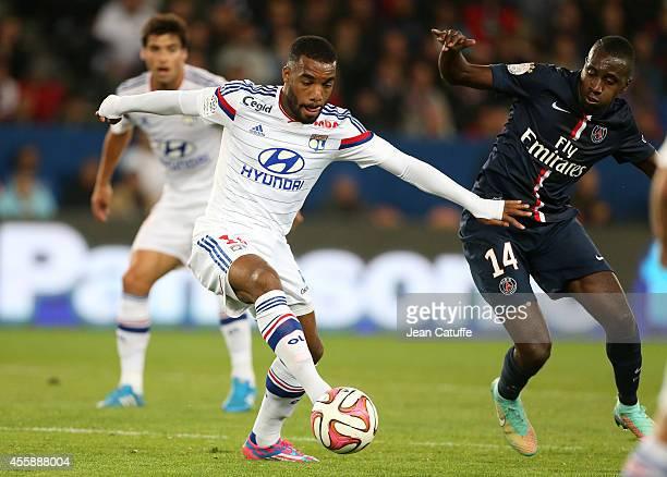 Alexandre Lacazette of Lyon and Blaise Matuidi of PSG in action during the Ligue 1 match between Paris SaintGermain FC and Olympique Lyonnais at Parc...
