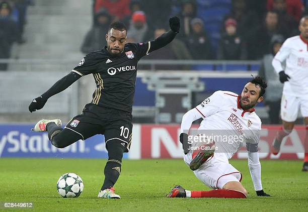 Alexandre Lacazette of Lyon and Vicente Iborra of Sevilla FC in action during the UEFA Champions League match between Olympique Lyonnais and Sevilla...