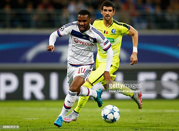 Alexandre Lacazette of Lyon battles for the ball with Stefan Mitrovic of Gent during the UEFA Champions League Group H match between KAA Gent and...