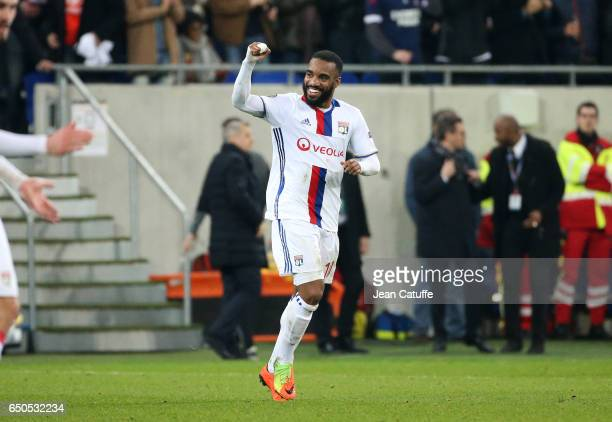 Alexandre Lacazette of Lyon celebrates his goal during the UEFA Europa League Round of 16 first leg match between Olympique Lyonnais and AS Roma at...