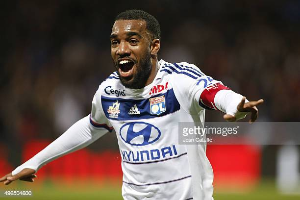 Alexandre Lacazette of Lyon celebrates his third goal during the French Ligue 1 match between Olympique Lyonnais and AS SaintEtienne at Stade de...