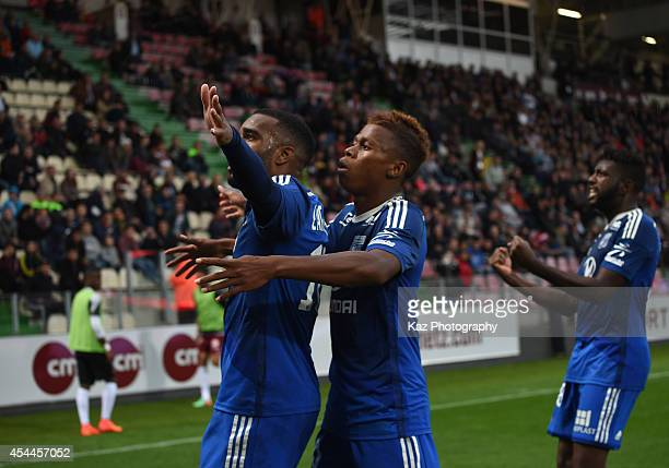 Alexandre Lacazette of Lyon celebrates scoring his team's first goal with his teammates Clinton N'Jie and Arnold Mvuemba during the French Ligue 1...