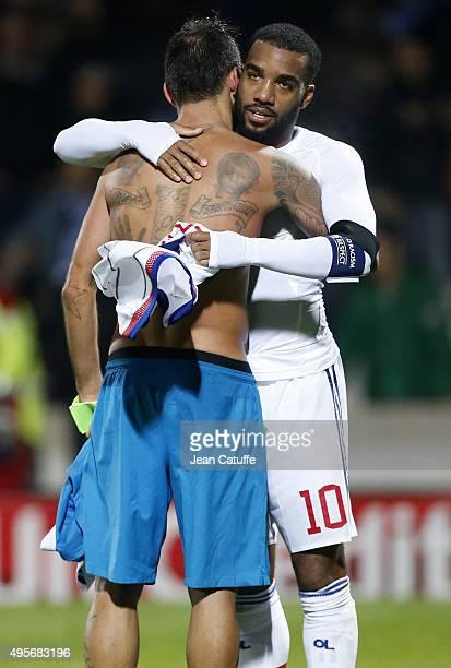 Alexandre Lacazette of Lyon greets Danny of FC Zenit following the UEFA Champions league match between Olympique Lyonnais and FC Zenit St Petersburg...