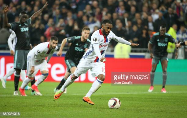 Alexandre Lacazette of Lyon scores his first goal on a penalty kick during the UEFA Europa League semi final second leg match between Olympique...