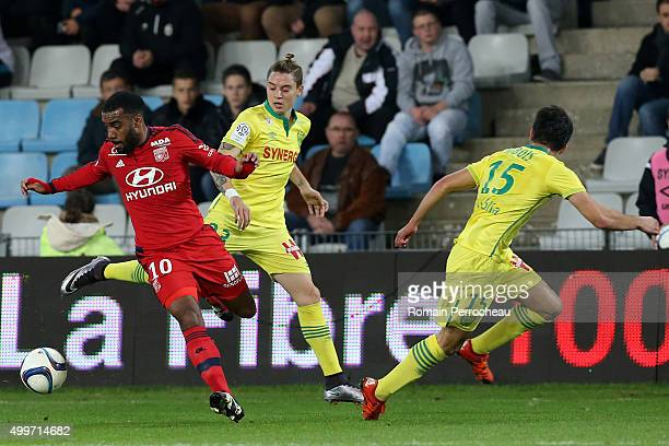 Alexandre Lacazette of Olympique Lyonnais and Adryan of Nantes FC battle for the ball during the French Ligue 1 game between Nantes FC and Olympique...