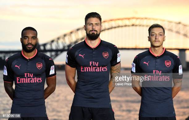 Alexandre Lacazette Olivier Giroud and Mesut Ozil of Arsenal launch the new Puma Arsenal 3rd kit on Fort Dennison on July 12 2017 in Sydney Australia