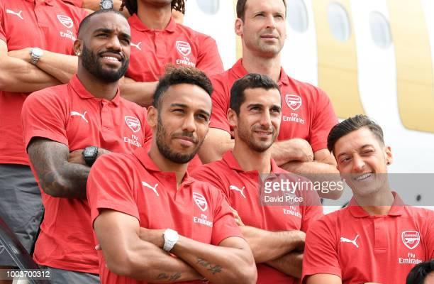 Alexandre Lacazette PierreEmerick Aubameyang Henrikh Mkhitaryan Mesut Ozil and Petr Cech of Arsenal on the steps of their plane before the head off...