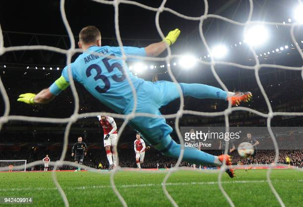 Alexandre Lacazette scores Arsenal's 2nd goal his 1st past Igor Akinfeev of CSKA during the UEFA Europa League quarter final leg one match between...