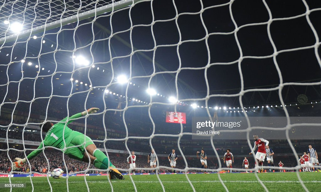 Alexandre Lacazette scores his and Arsenal's 2nd goal from the penalty spot during the Premier League match between Arsenal and West Bromwich Albion at Emirates Stadium on September 25, 2017 in London, England.