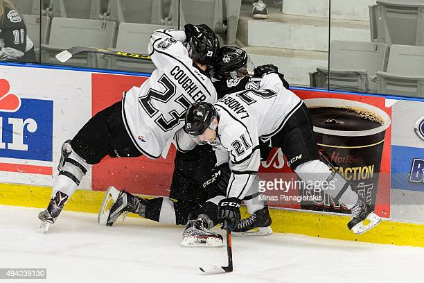 Alexandre Landreville and teammate Jake Coughler of the Gatineau Olympiques check Yvan Mongo of the BlainvilleBoisbriand Armada during the QMJHL game...
