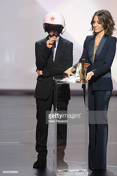 Alexandre Longo aka Cascadeur receives from Virginie Guilhaume the electronic music award for the album 'Ghost surfer' during the 30th 'Victoires de...