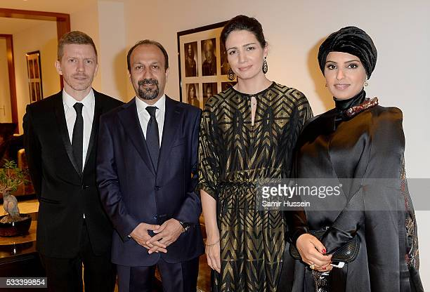 Alexandre MalletGuy director Asghar Farhadi Hanaa Issa and Doha Film Institue CEO Fatma Al Remaihi pose prior to the The Salesman Premiere at the...