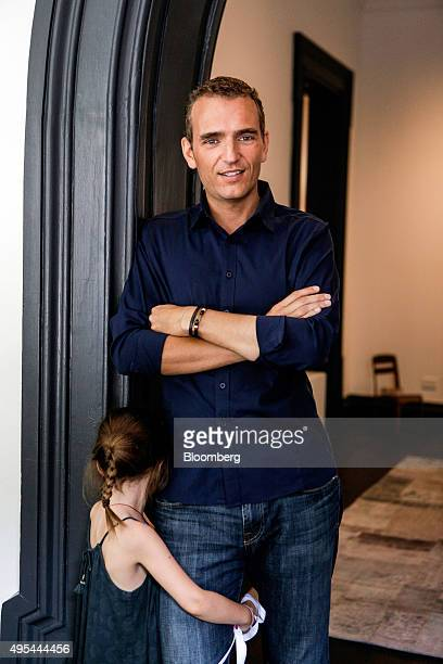 Alexandre Mars founder of the New Yorkbased charity called the Epic Foundation poses for a photograph with his daughter before an interview in his...