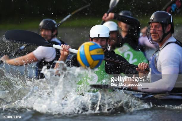 Alexandre Massot of Acigne 1 battles for the ball with Bert Vlaeminck of Gent during the GEKKO International Canoe Kayak Polo Tournament match...